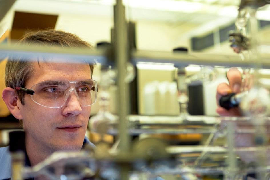 A man with glasses works in a laboratory